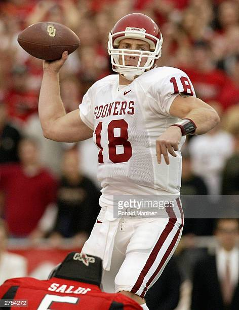 Quarterback Jason White of the Oklahoma Sooners drops back to pass against the Texas Tech Red Raiders on November 22, 2003 at Jones SBC Stadium in...