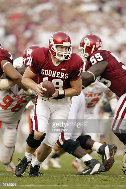 Quarterback Jason White of the Oklahoma Sooners hands the ball off during the game against the Oklahoma State Cowboys on November 1 2003 at Memorial...