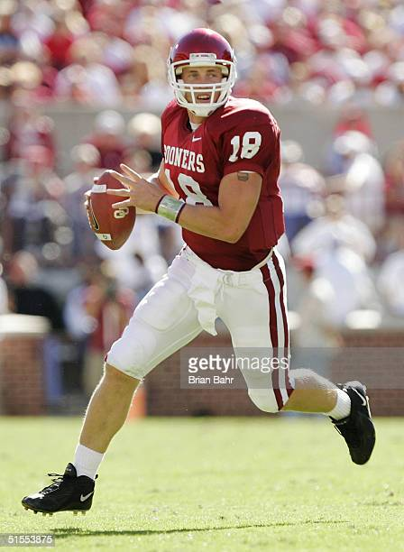 Quarterback Jason White of the Oklahoma Sooners rolls out to pass against the Kansas Jayhawks in the fourth quarter on October 23, 2004 at Memorial...