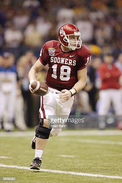 Quarterback Jason White of the Oklahoma Sooners scrambles during the game against the Louisiana State Tigers in the Nokia Sugar Bowl National...