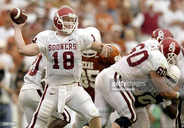 Quarterback Jason White of the Oklahoma Sooners throws a touchdown pass against the Texas Longhorns at the Cotton Bowl on October 11 2003 in Dallas...
