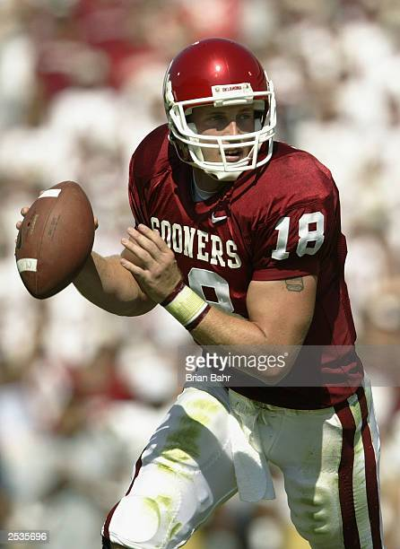Quarterback Jason White of the University of Oklahoma Sooners scramles against the University of California Los Angeles Bruins at Memorial Stadium on...
