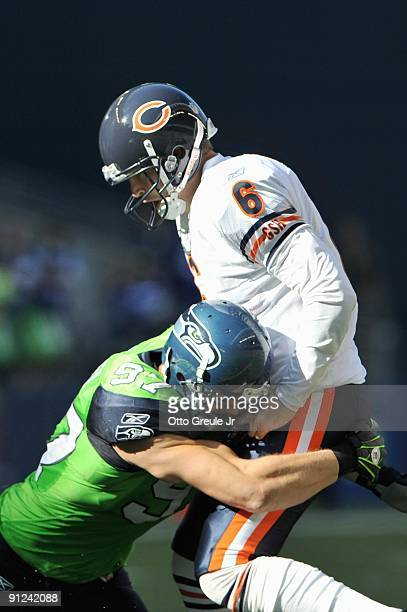 Quarterback Jay Cutler 36 of the Chicago Bears is sacked by Patrick Kerney of the Seattle Seahawks on September 27 2009 at Qwest Field in Seattle...