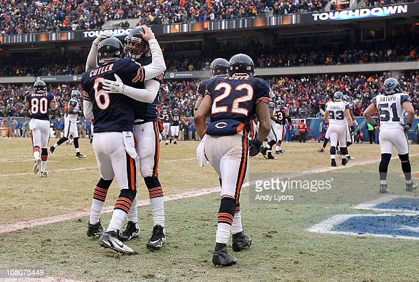 Quarterback Jay Cutler of the Chicago Bears celebrates with teammate Greg Olsen after Cutler scores on a nine-yard touchdown run in the third quarter...