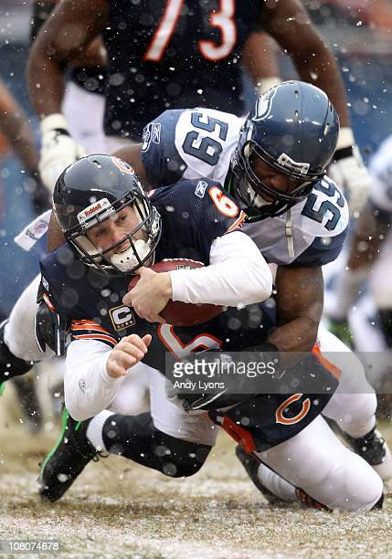 Quarterback Jay Cutler of the Chicago Bears dives into the endzone to score on a six-yard run against Aaron Curry of the Seattle Seahawks in the...