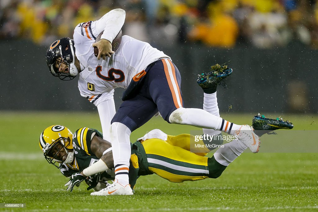 Quarterback Jay Cutler #6 of the Chicago Bears falls over Sam Shields #37 of the Green Bay Packers in the second quarter at Lambeau Field on November 26, 2015 in Green Bay, Wisconsin. The Chicago Bears defeated the Green Bay Packers 17 to 13.