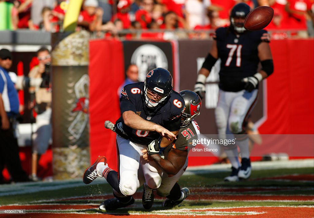 Quarterback Jay Cutler #6 of the Chicago Bears fumbles the ball after being hit by defensive end Robert Ayers #91 of the Tampa Bay Buccaneers in the end zone leading to a safety during the third quarter of an NFL game on November 13, 2016 at Raymond James Stadium in Tampa, Florida.