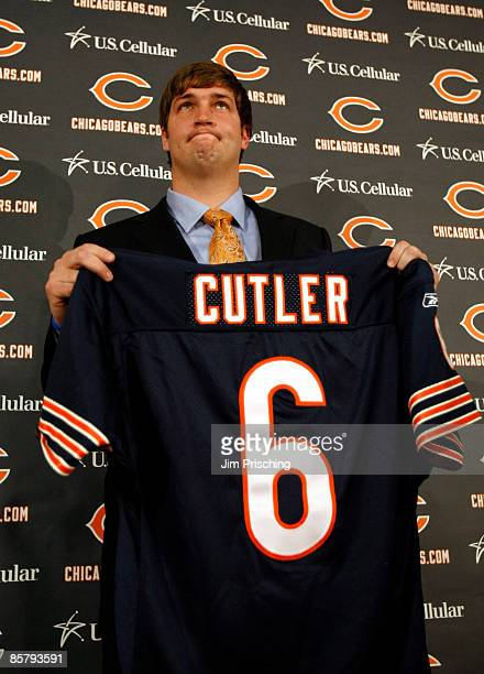 Quarterback Jay Cutler of the Chicago Bears holds up his jersey after he was introduced as their new quarterback during a press conference on April...
