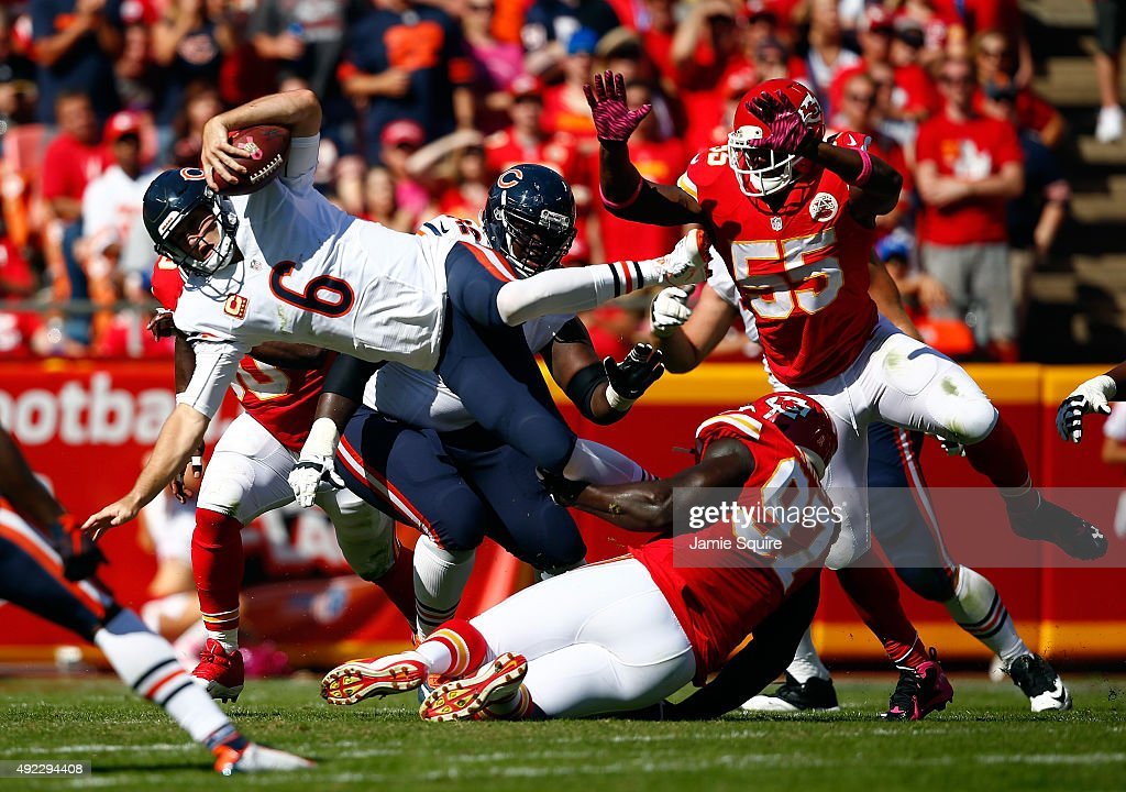 Quarterback Jay Cutler #6 of the Chicago Bears is upended as while scrambling during the 2nd half of the game against the Kansas City Chiefs at Arrowhead Stadium on October 11, 2015 in Kansas City, Missouri.