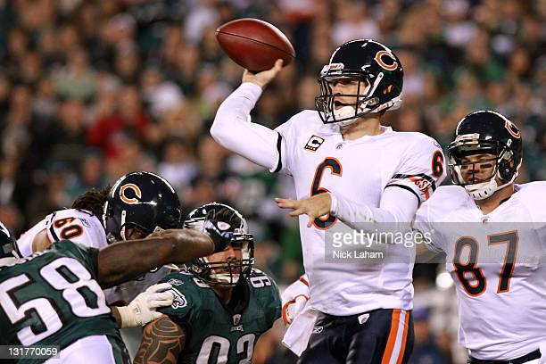 Quarterback Jay Cutler of the Chicago Bears passes against Trent Cole and Jason Babin of the Philadelphia Eagles during the second quarter of the...