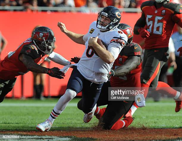 Quarterback Jay Cutler of the Chicago Bears scrambles for a first down in the fourth quarter at Raymond James Stadium on December 27 2015 in Tampa...