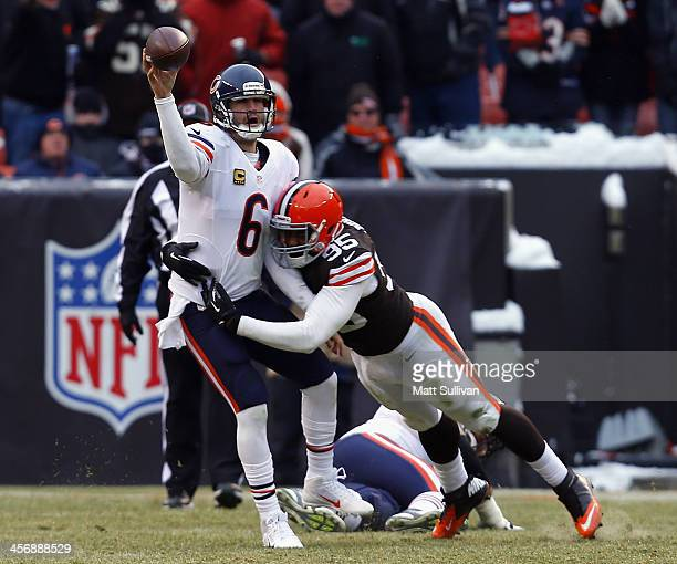 Quarterback Jay Cutler of the Chicago Bears throws to a receiver as he is hit by defensive lineman Armonty Bryant the Cleveland Browns at FirstEnergy...
