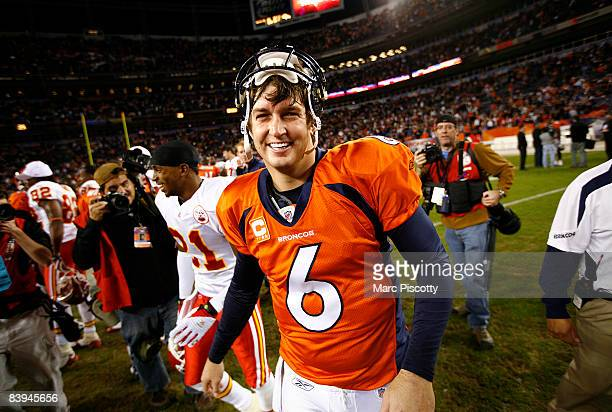 Quarterback Jay Cutler of the Denver Broncos flashes a big smile as he shakes hands after beating the Kansas City Chiefs in week 14 NFL action at...