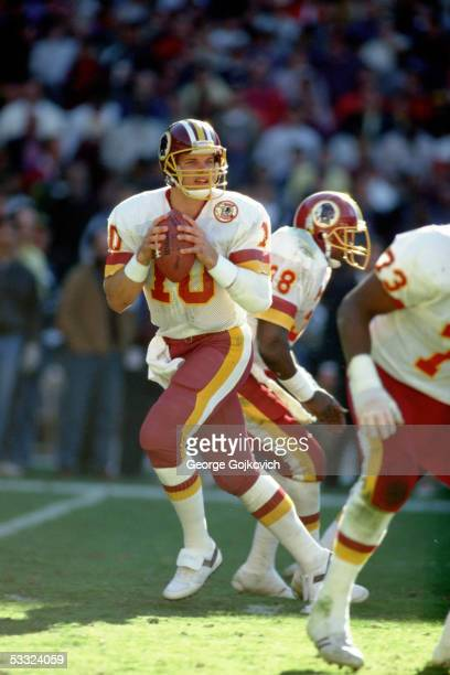 Quarterback Jay Schroeder of the Washington Redskins drops back to pass against the St Louis Cardinals at RFK Stadium on October 19 1986 in...
