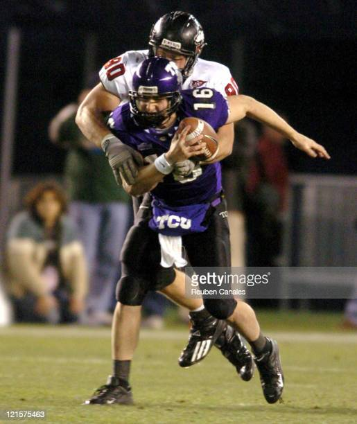 Quarterback Jeff Ballard of the TCU Horned Frogs is sacked by Huskies defensive end Ed Jackson in a 37 to 7 victory over the NIU Huskies in the San...
