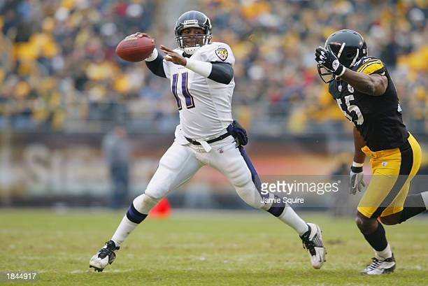 Quarterback Jeff Blake of the Baltimore Ravens attempts to pass while evading a tackle by outside linebacker Joey Porter of the Pittsburgh Steelers...