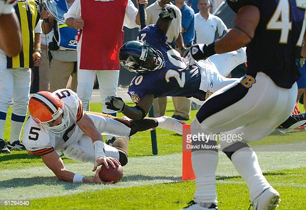 Quarterback Jeff Garcia of the Cleveland Browns scores a touchdown as safety Ed Reed of the Baltimore Ravens defends during the fourth quarter on...