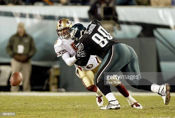 Quarterback Jeff Garcia of the San Francisco 49ers fumbles the ball after being hit by Corey Simon of the Philadelphia Eagles on December 21 2003 at...