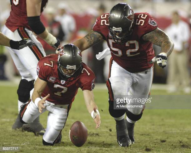 Quarterback Jeff Garcia of the Tampa Bay Buccaneers reaches for a loose football against the Seattle Seahawks at Raymond James Stadium on October 19...