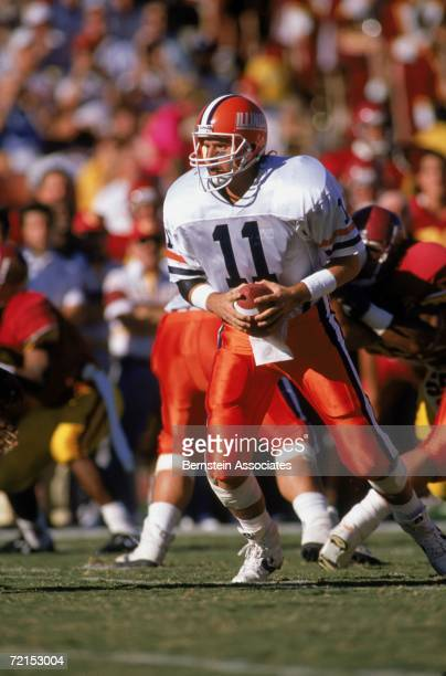 Quarterback Jeff George of the Illinois Fighting Illini drops back to pass during the game against the USC Trojans at the Los Angeles Memorial...