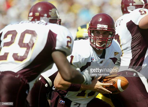 Quarterback Jeff Perry of the Central Michigan Chippewas hands the ball to his halfback Terrence Jackson during the game against the University of...