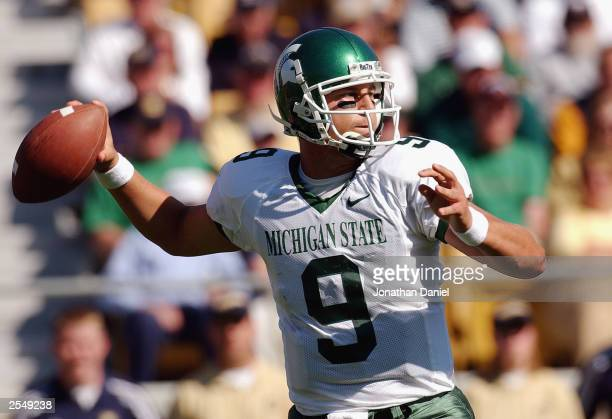 Quarterback Jeff Smoker of Michigan State throws the ball downfield during a game against Michigan State on September 20 2003 at the Notre Dame...