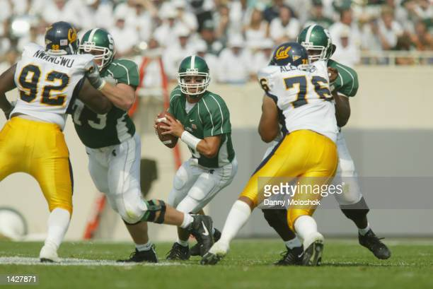 Quarterback Jeff Smoker of the Michigan State Spartans looks to pass against the California Golden Bears on September 14 2002 at Spartan Stadium in...