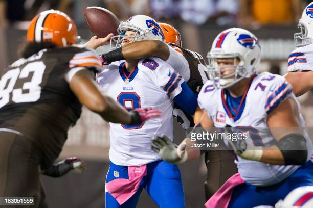 Quarterback Jeff Tuel of the Buffalo Bills is sacked by defensive end Armonty Bryant of the Cleveland Browns during the second half at FirstEnergy...