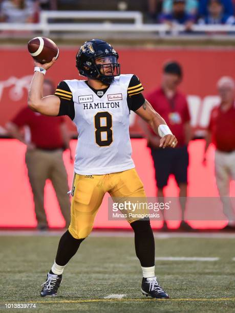 Quarterback Jeremiah Masoli of the Hamilton TigerCats prepares to play the ball against the Montreal Alouettes during the CFL game at Percival Molson...