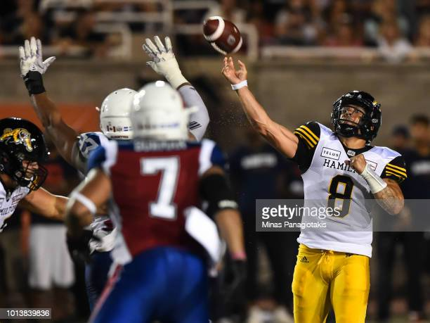 Quarterback Jeremiah Masoli of the Hamilton TigerCats throws the ball against the Montreal Alouettes during the CFL game at Percival Molson Stadium...