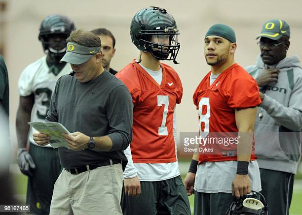 Quarterback Jeremiah Masoli of the Oregon Ducks looks on as head coach Chip Kelly directs practice during the first day of spring practice on March...