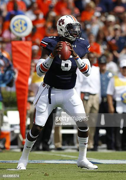 Quarterback Jeremy Johnson of the Auburn Tigers drops back to pass during the game against the Arkansas Razorbacks at Jordan Hare Stadium on August...