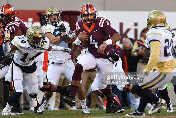 Quarterback Jerod Evans of the Virginia Tech Hokies carries the ball against the Georgia Tech Yellow Jackets in the first half at Lane Stadium on...