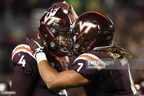 Quarterback Jerod Evans of the Virginia Tech Hokies celebrates his touchdown throw with tight end Bucky Hodges in the second half against the Miami...