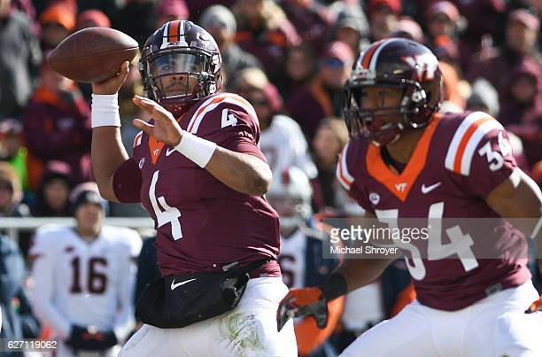 Quarterback Jerod Evans of the Virginia Tech Hokies looks to pass against the Virginia Cavaliers in the first half at Lane Stadium on November 26...