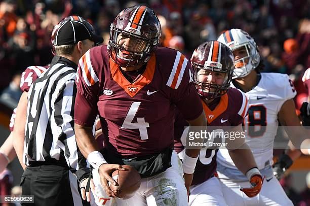 Quarterback Jerod Evans of the Virginia Tech Hokies reacts following his touchdown run against the Virginia Cavaliers in the first half at Lane...