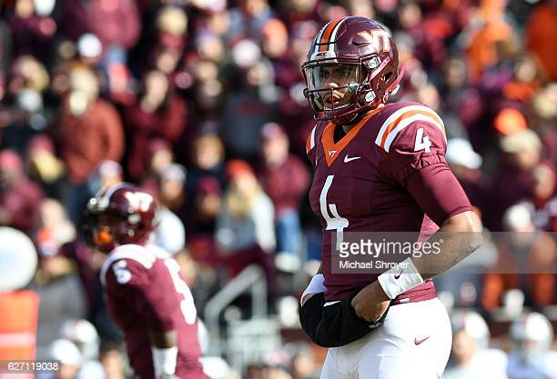 Quarterback Jerod Evans of the Virginia Tech Hokies surveys the defense prior to taking a snap against the Virginia Cavaliers in the first half at...