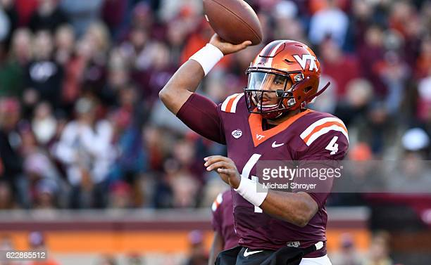 Quarterback Jerod Evans of the Virginia Tech Hokies throws against the Georgia Tech Yellow Jackets in the first half at Lane Stadium on November 12...