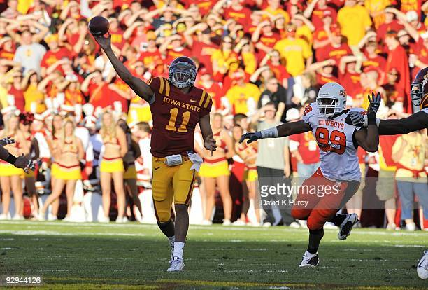 Quarterback Jerome Tiller of the Iowa State Cyclones passes under pressure from defensive end Richetti Jones of the Oklahoma State Cowboys in the...