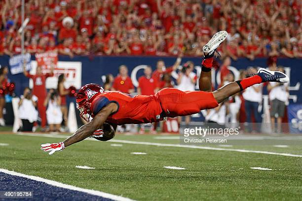 Quarterback Jerrard Randall of the Arizona Wildcats dives into the end zone to score on a 39-yard rushing touchdown against the UCLA Bruins during...