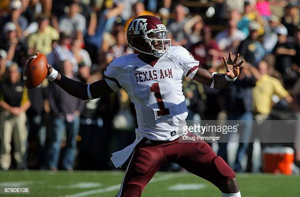 Quarterback Jerrod Johnson of the Texas A&M Aggies delivers a pass against the Colorado Buffaloes during NCAA college football action at Folsom Field...