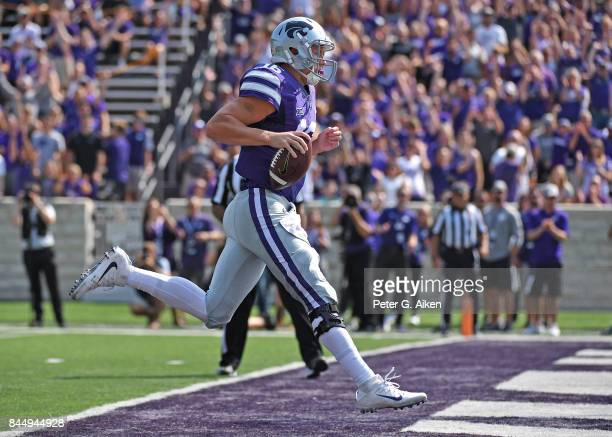 Quarterback Jesse Ertz of the Kansas State Wildcats rushes for a touchdown against the Charlotte 49ers during the first half on September 9 2017 at...