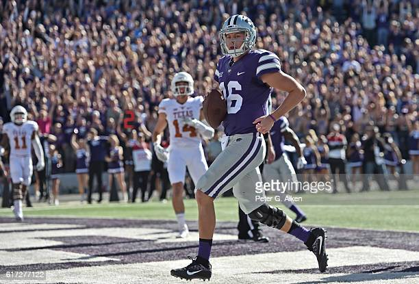Quarterback Jesse Ertz of the Kansas State Wildcats scrambles into the end zone for a touchdown against the Texas Longhorns during the first half on...