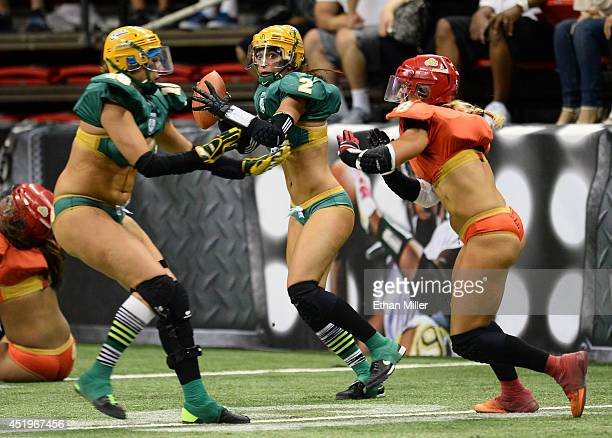 Quarterback Jessica Peyton of the Green Bay Chill scrambles under pressure from Danika Brace of the Las Vegas Sin as Theresa Garay of the Chill moves...