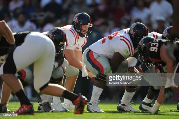 Quarterback Jevan Snead of the Mississippi Rebels drops back to pass against the Texas Tech Red Raiders during the AT&T Cotton Bowl on January 2,...