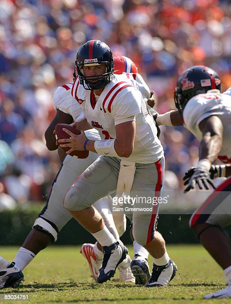 Quarterback Jevan Snead of the Ole Miss Rebels prepares to hand off the ball in a game against the Florida Gators at Ben Hill Griffin Stadium on...