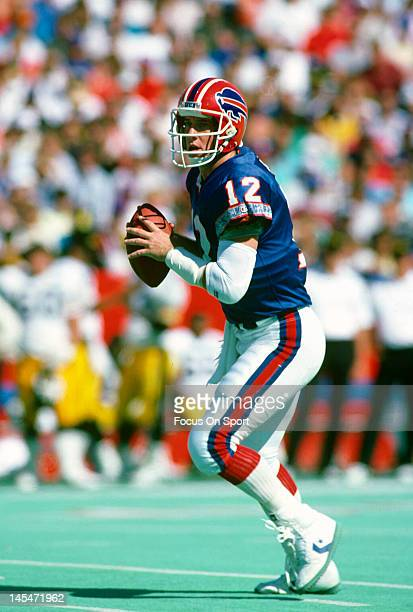 Quarterback Jim Kelly of the Buffalo Bills drops back to pass against the Pittsburgh Steelers during an NFL football game September 25 1988 at Rich...