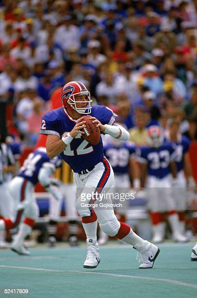 Quarterback Jim Kelly of the Buffalo Bills fades back to pass during an NFL game against the Miami Dolphins on September 9 1988 at Rich Stadium in...