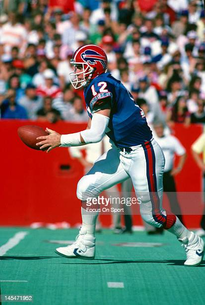 Quarterback Jim Kelly of the Buffalo Bills turns to hand the ball off against the Pittsburgh Steelers during an NFL football game September 25 1988...