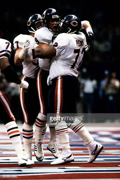 Quarterback Jim McMahon of the Chicago Bears congratulates William Perry after scoring a touchdown in Super Bowl XX against the New England Patriots...